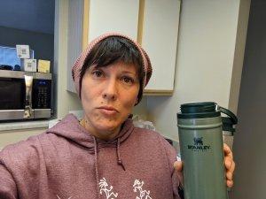 christina holding a stanley mug